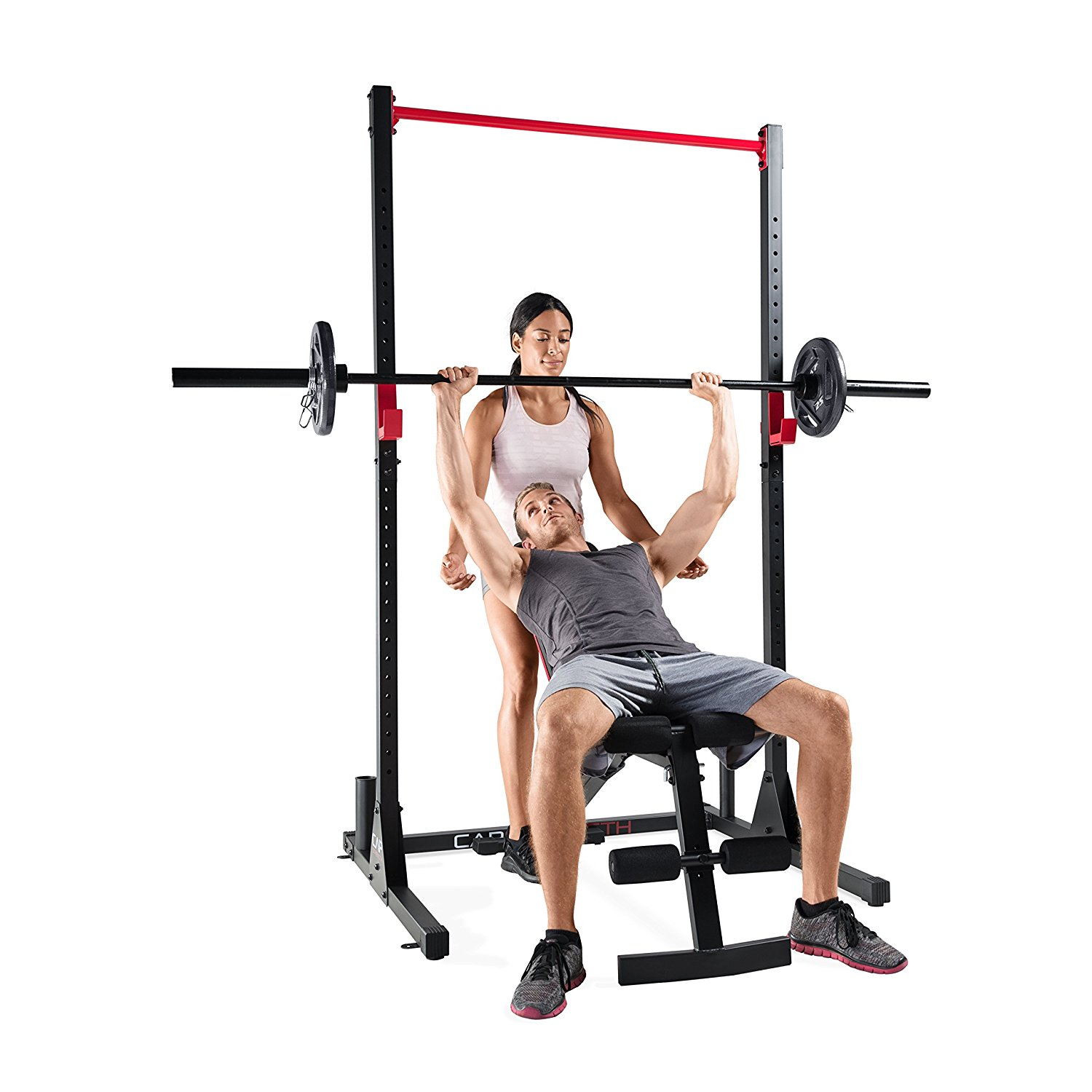 squat rack with guy doing bench press